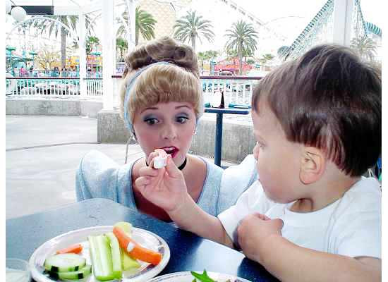 Offering Cinderella a carrot at Ariel's Grotton {Saving up for Disney}